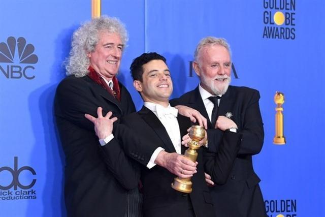 Dos de los miembros de Queen junto al mejor actor protagonista, Rami Malek